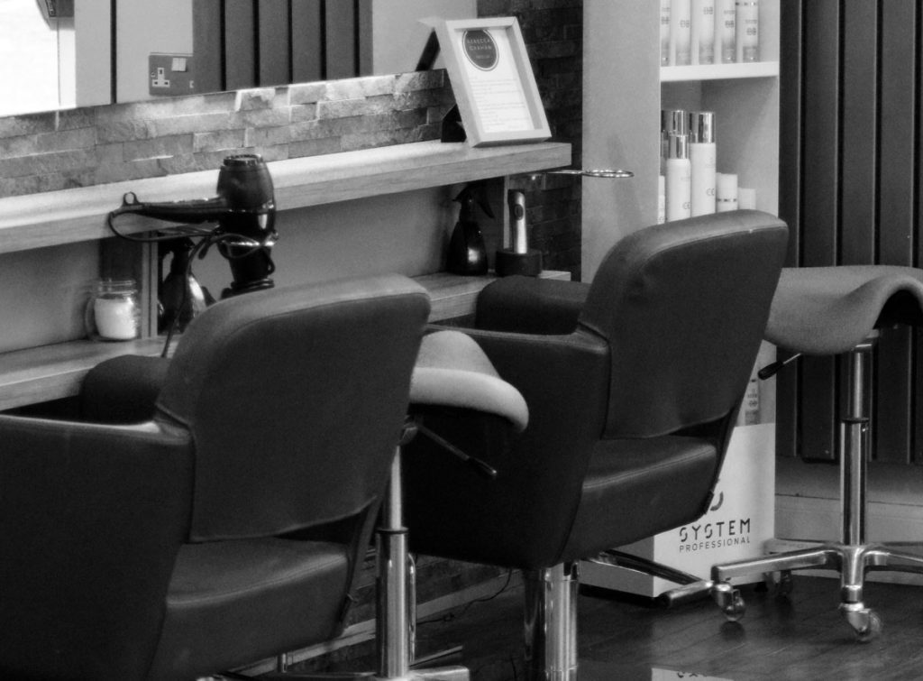 Hair salon chair with products