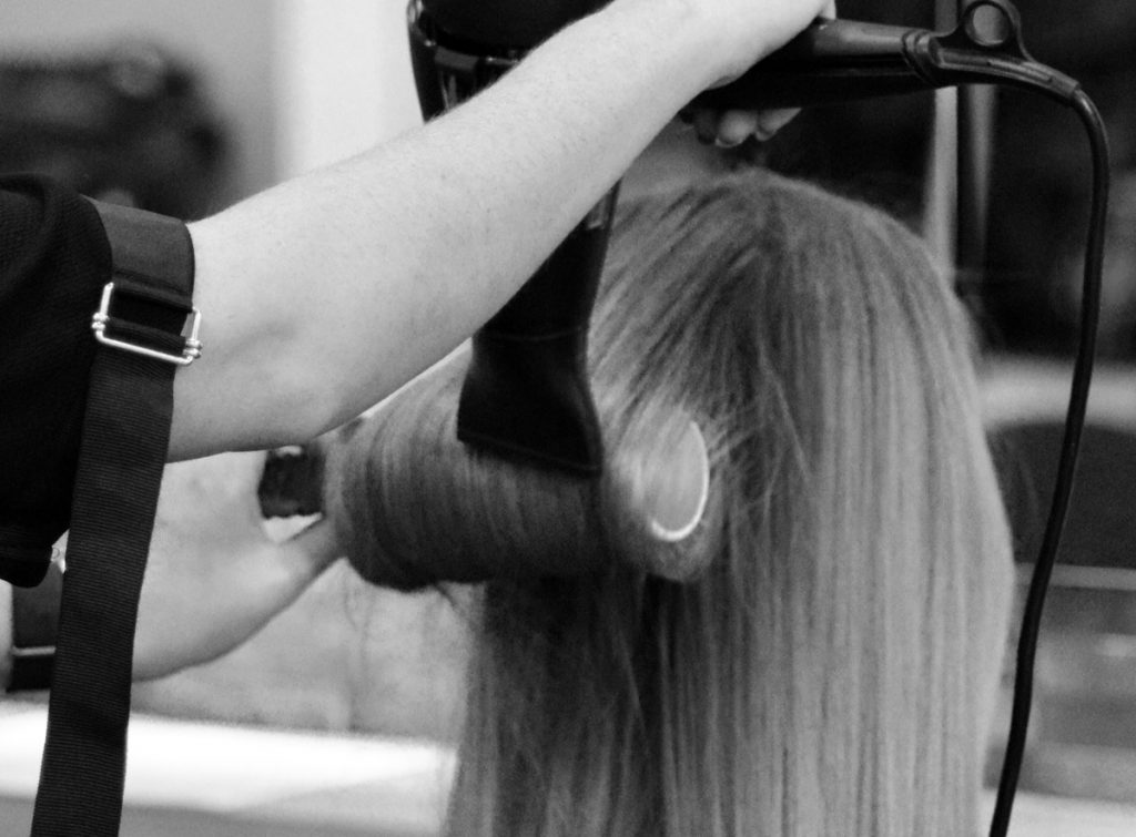 Professional stylist doing blow dry